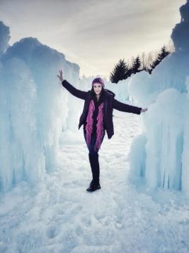 Carla Standing between Ice Walls